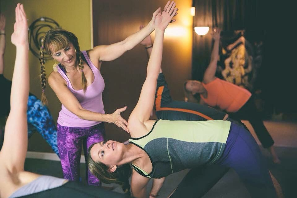 Sam with her first teacher, Marti Lee Bowen at InBliss Yoga in Kansas City, MO