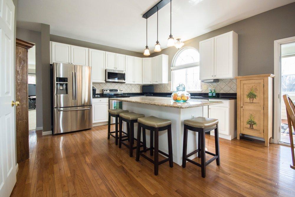 Open Kitchen with Hardwood Floors