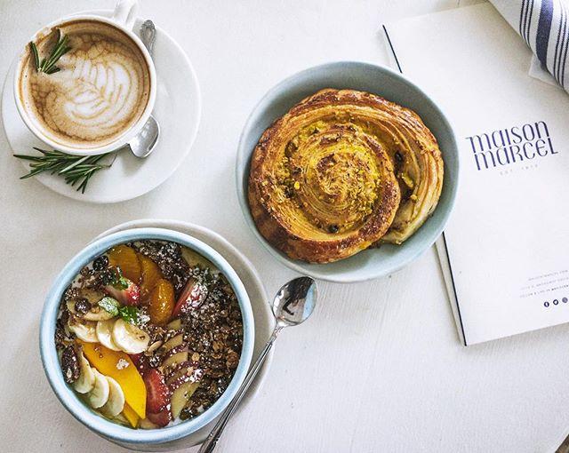 A gorgeous breakfast of Parfait Granola, Pain á la Pistache and Rosemary Latte 🌿#Maisonmarcel Photo: @rach.bires