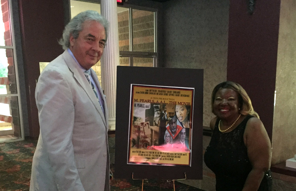 Wilson Wages plays a judge in the film, M. Pearls AAL, The Movie, written and produced by Emily Kirk (right), who is also the lead actress.