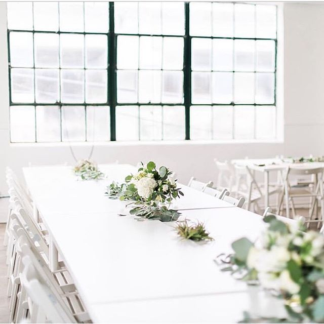 If you ask us how we like to style our events, we would do it exactly how @heirloom_mag did! Clean lines, greenery and white to accent our industrial vibe! . . . 📷: @cottonwoodroadphotography