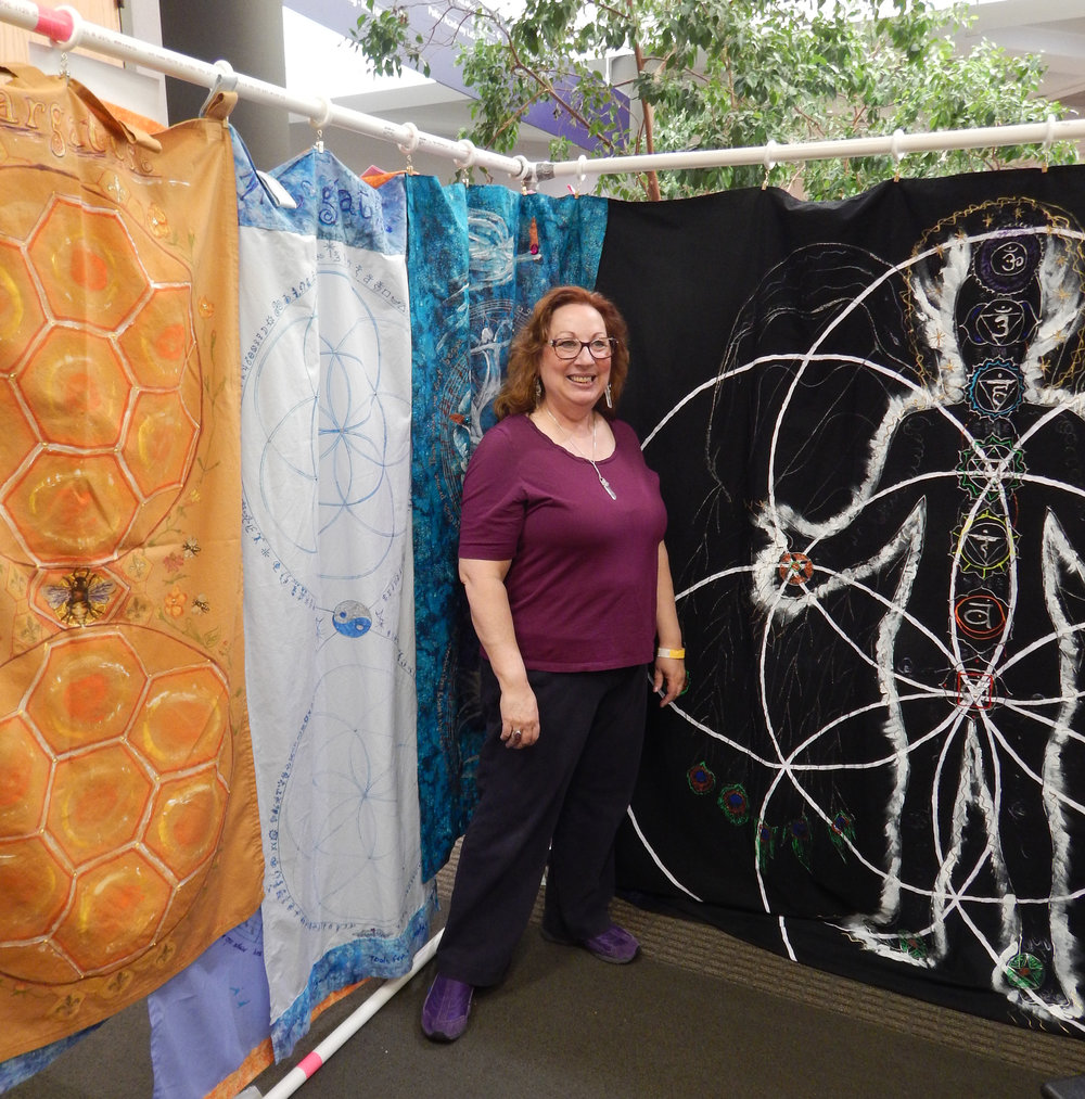 Sue paints lifesize Portals to call in the highest healing powers from other dimensions. Used as draping for massage tables, sitting or lying on them, or as wall art, sacred geometry, imagery and color are consciously designed. Pieces can be made to order.