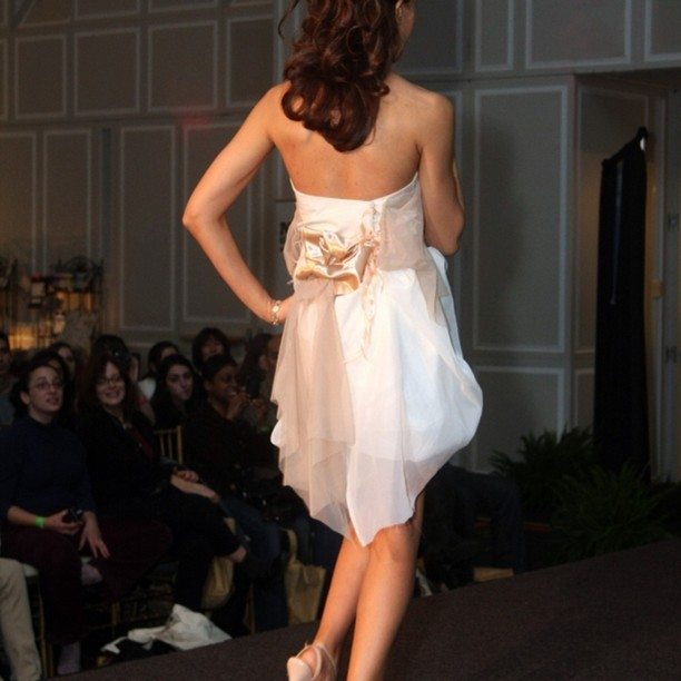 I loved the soft ecru satin details and shell pink ties on the back of this cream cotton gown. The skirt was 2 layers with wispy cream asymmetrical panels. #cottonwedding #shortweddingdress #corsetbridalgown #receptiondress #wispychic #ethereal #cream #customweddingdress