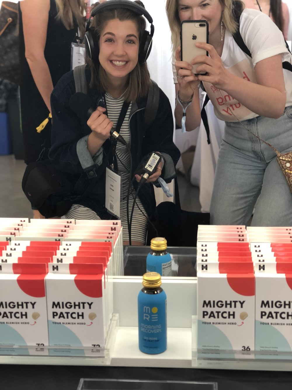 Co-Host Carlene Higgins (right) with sound tech Olivia Nashmi on location at the Hero Cosmetics booth during FounderMade's Consumer Discovery Show in New York
