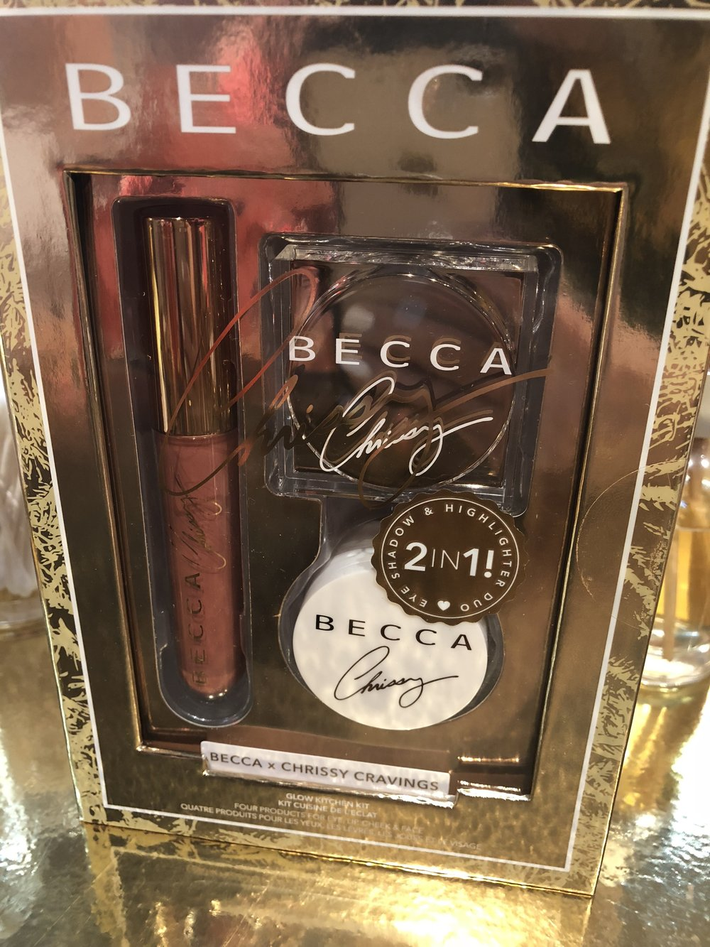 - Becca x Chrissy Teigen's scented holiday glow kit