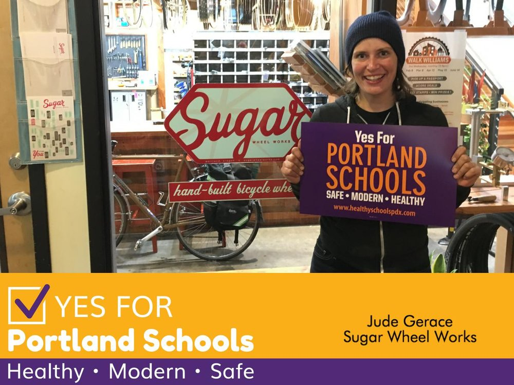 A photo of Jude Gerace in front of her bike shop.