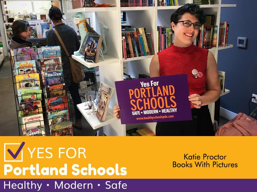 A photo of Katie Proctor, small business owner, holding a sign in support for the Portlanders for Safe and Healthy Schools campaign.
