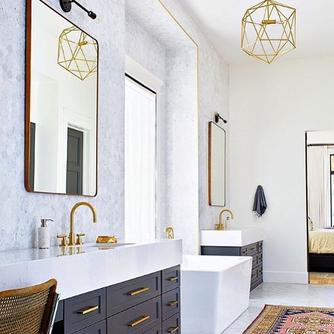 Brass yourself for this amazing bathroom that is mixed with so many different materials and a hint of color!! 📸: @luxemagazine #WeAreParadigm