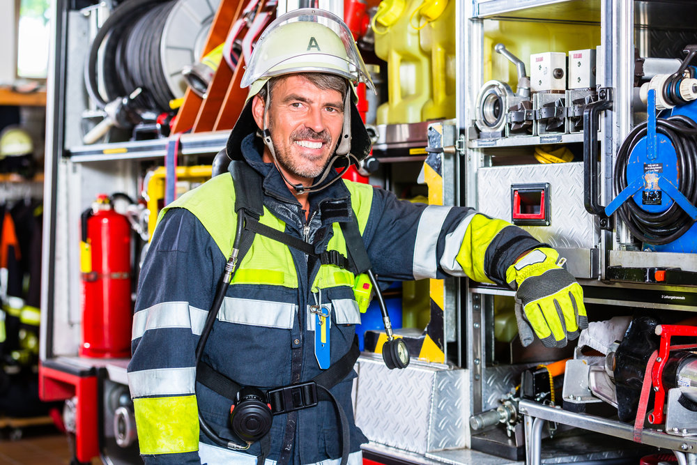 bigstock-Fire-fighter-in-uniform-leanin-145158299.jpg