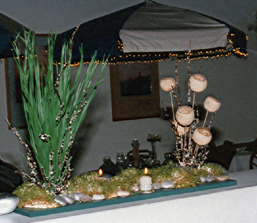 reception decor - dried greens and pods, votive candles, fresh chia grass, silver rocks
