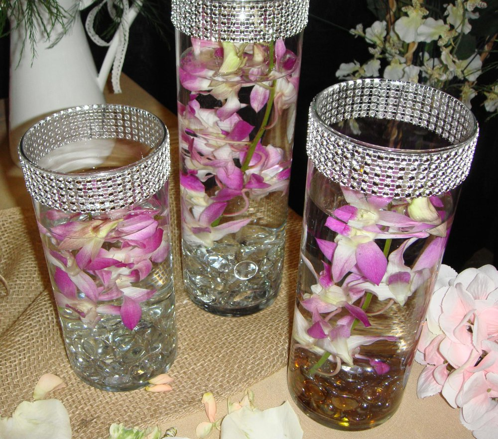 table centerpiece/reception decor - fresh flowers, glass beads, submersible lights