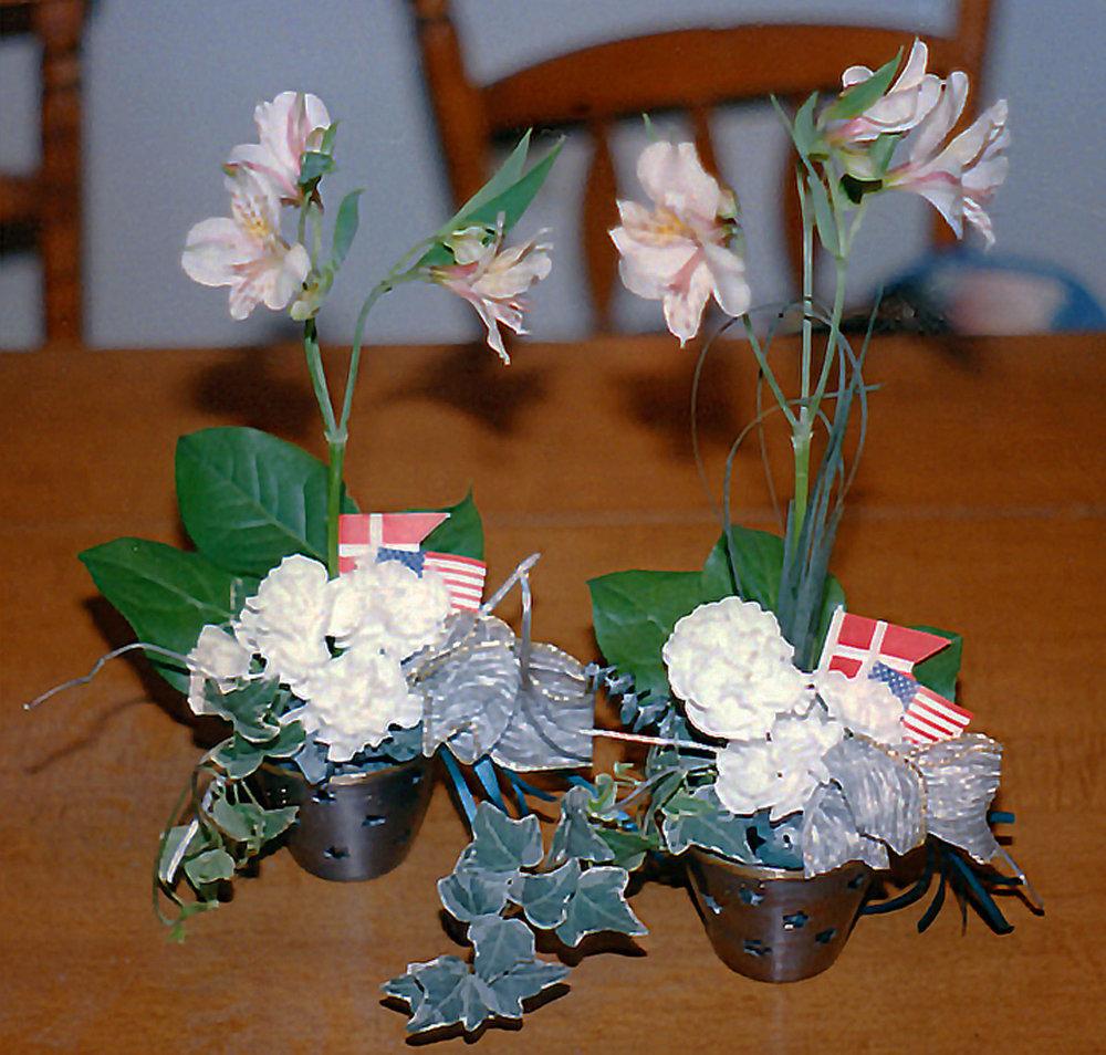 table centerpieces / reception decor - fresh flowers, flags, metal votive holders