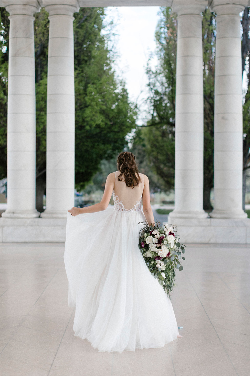 Bride with over-sized cascade bouquet - fresh flowers