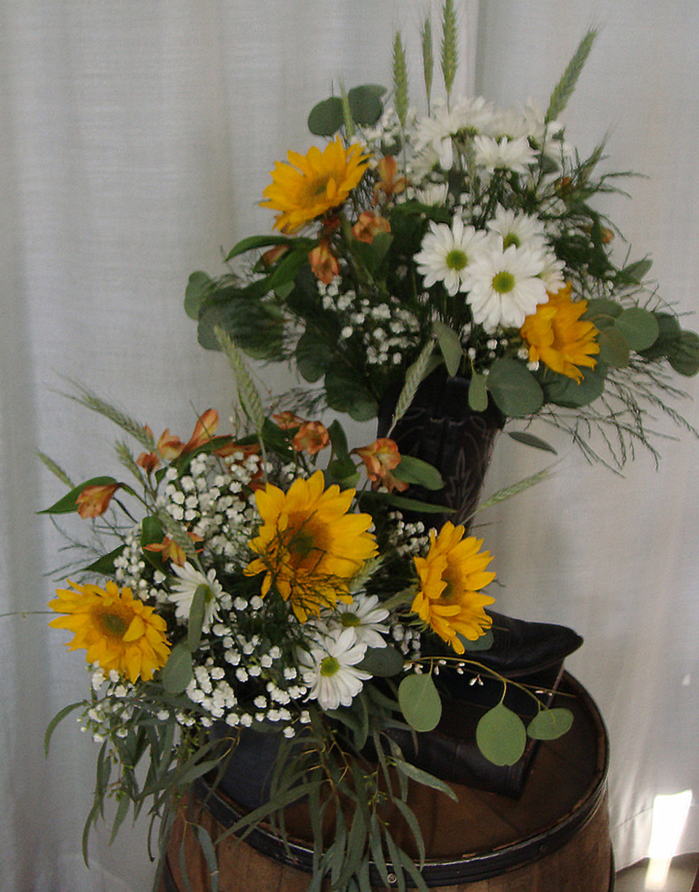 ceremony arrangements for outdoor, western or country ceremony - fresh flowers on  whisky barrel
