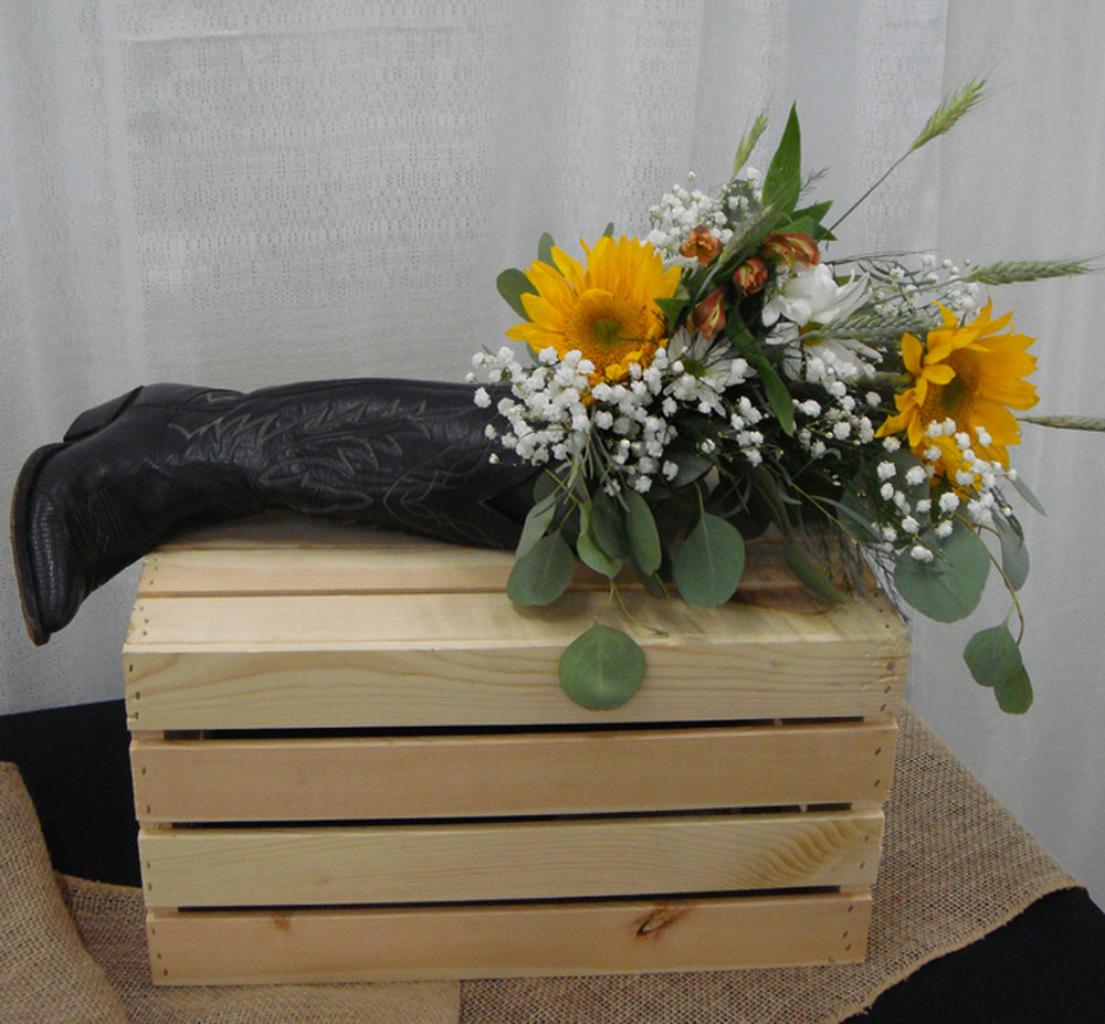 low profile reception/event decor - fresh flowers in cowboy boot (on side)