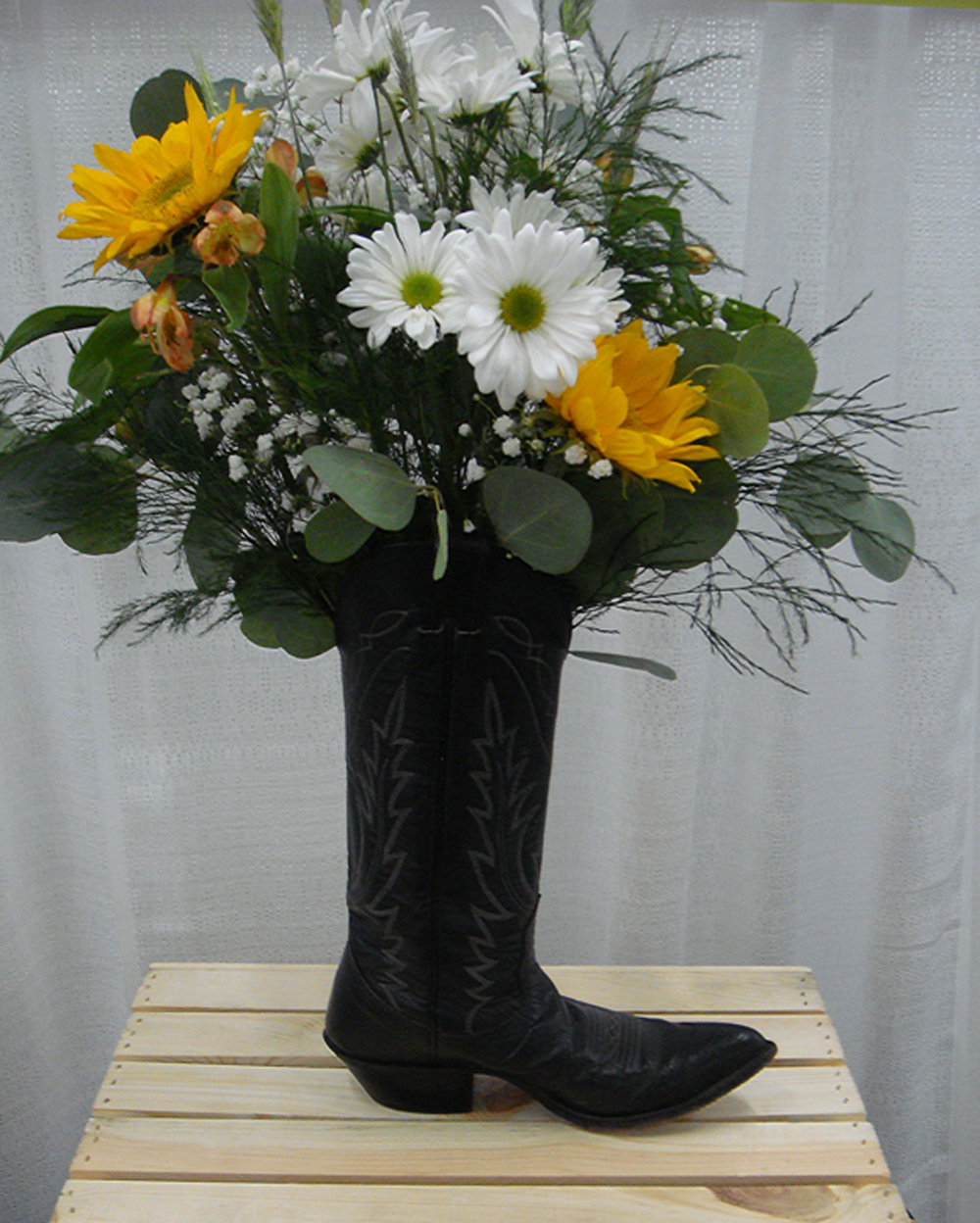 reception/event decor or centerpiece - fresh flowers in cowboy boot
