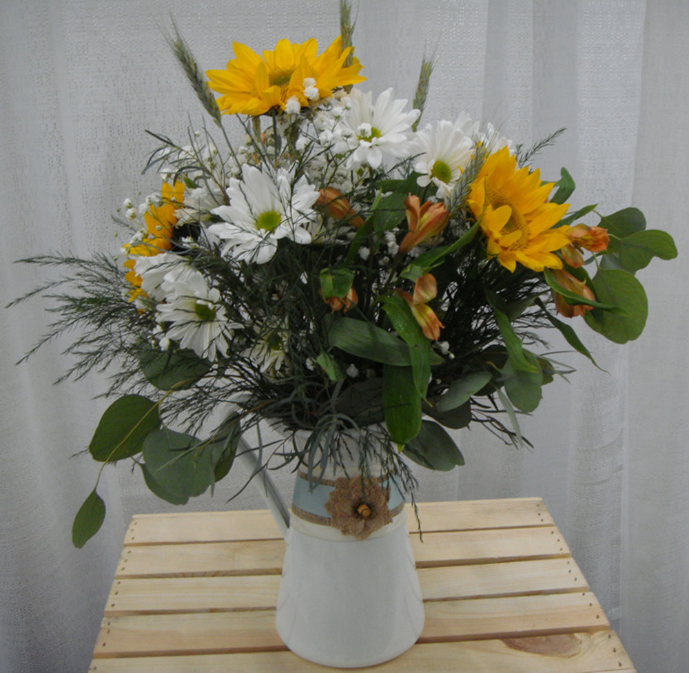 reception centerpiece or accent decor - fresh flowers in milk pitcher