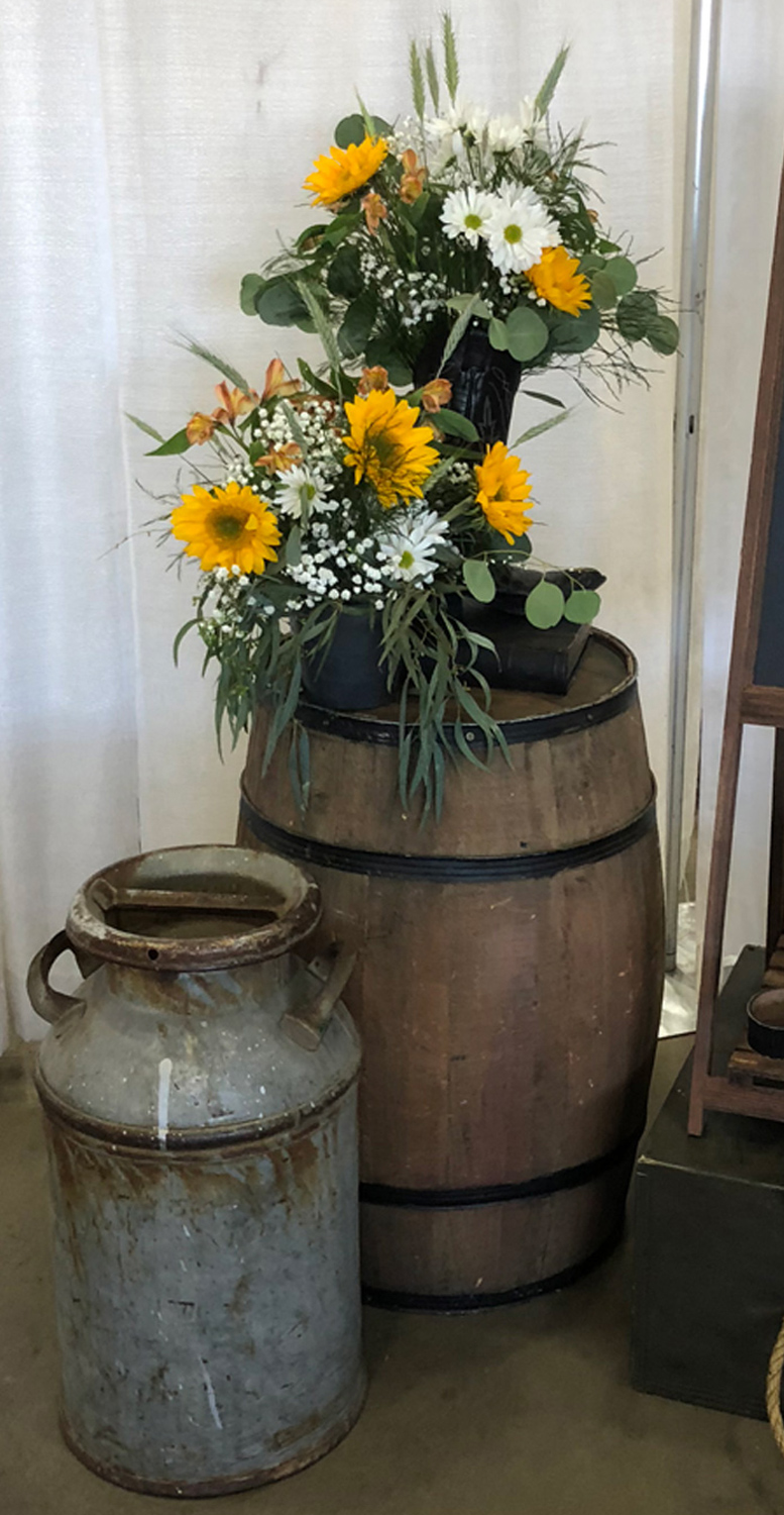 western / country theme event decor - fresh and silk flowers with antiques