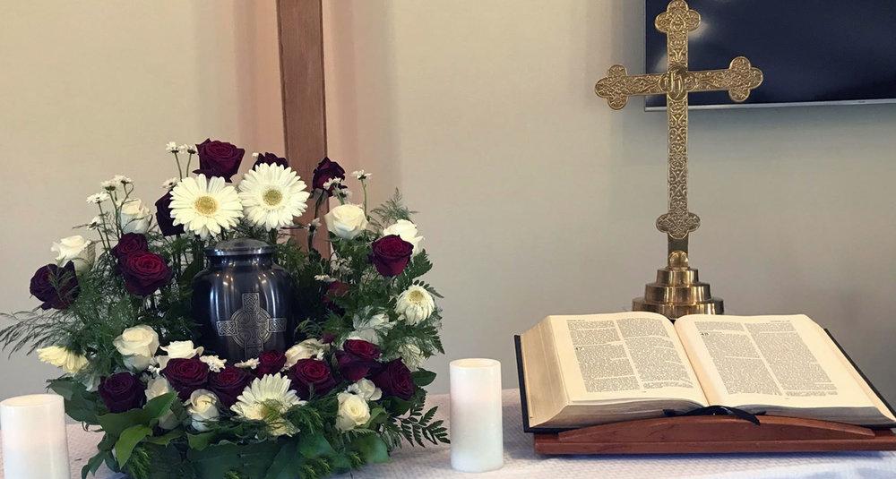 urn with wreath arrangement - fresh flowers