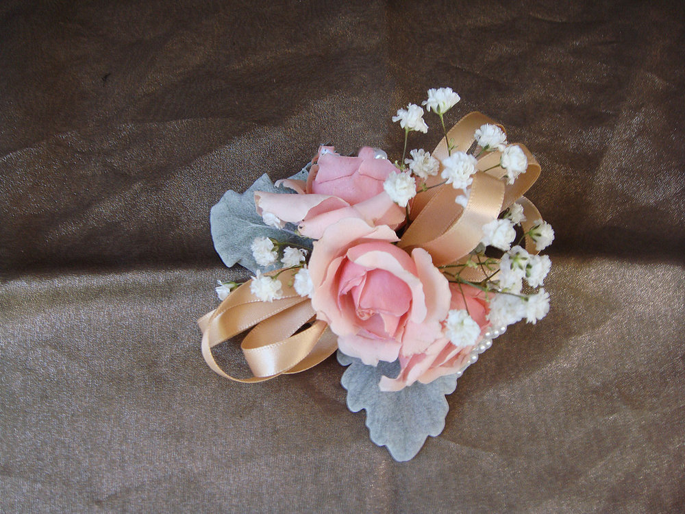 wrist corsage - fresh flowers, satin bow on pearl wristlet