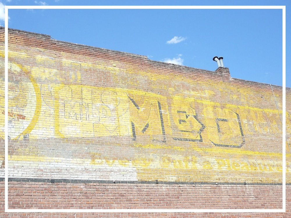 Historic signage on a brick warehouse in Denver, CO.
