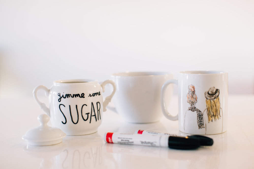 If you know us (or if you've been following along and seen all of our coffee posts) you know we drink A LOT of coffee. Of course we enjoy the caffeine boost but more so we love the taste. We also love to drink it in cute mugs because it tastes better that way! Am I right? We thought it would be fun to share this easy DIY mug tutorial with you so that you can make some for yourself and friends! They are completely dishwasher safe which is the best part! I included a simple one and another with more detail.