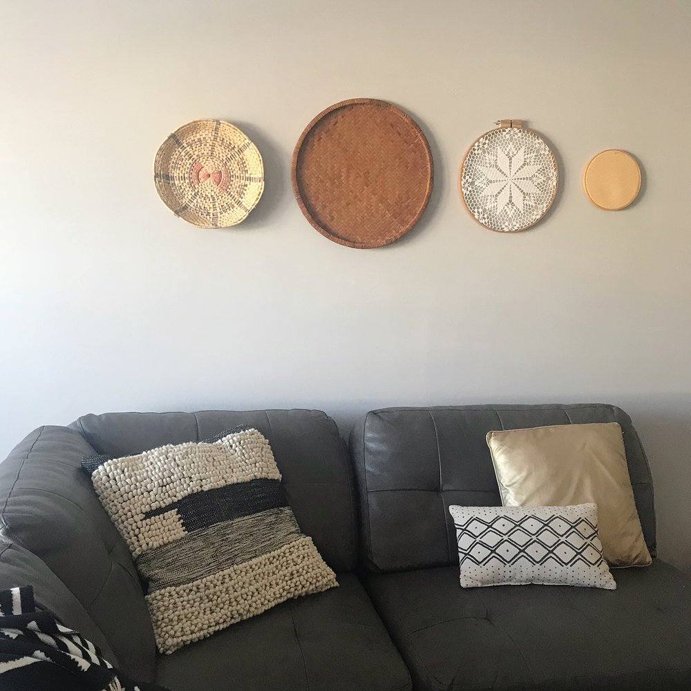 I'm thrifting for more baskets to hang on this wall behind our seating area, and it will be more of a collage.
