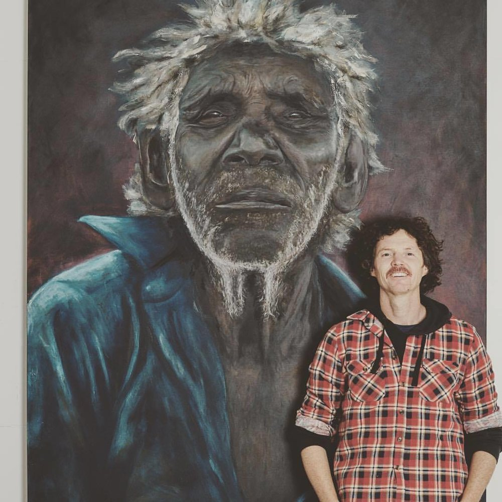 David Darcey next to his portrait of Paddy Willis