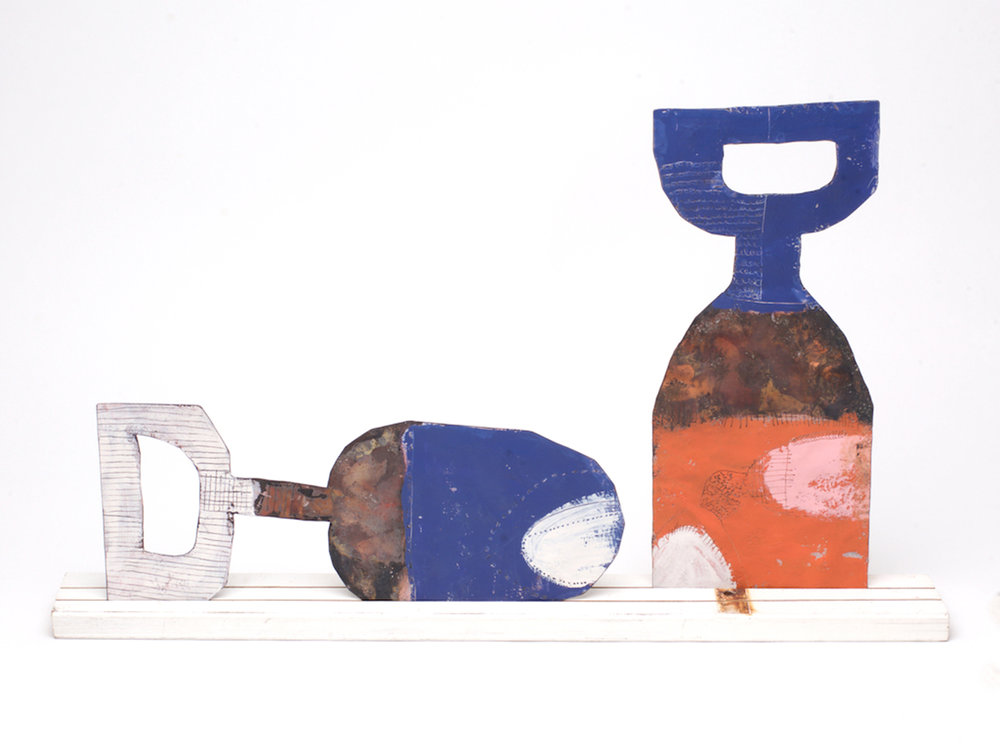 Family 1 Large spoon - Blue & white front / moss green & blue back Large fork - Orange & pink & blue front / orange & white back On a large re-purposed white picket fence Copper, paint and enamel 600 x 360 mm