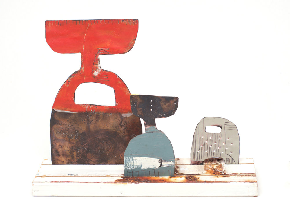 Family 3 Medium fork - Red front / light blue Small fork - teal front /pink grey Small Cheese grater - grey front / red back On a medium re-purposed white picket fence Copper, paint and enamel 270 x 220 mm