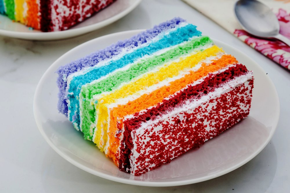 Rainbow Pastry - If you've ever wondered what a rainbow tasted like, well, now you can finally know. Layers of vanilla pound-cake coloured in the shades of the rainbow are blanketed with sweet cream-cheese and topped off with red-velvet crumble. Tell us if you spot a unicorn, okay?