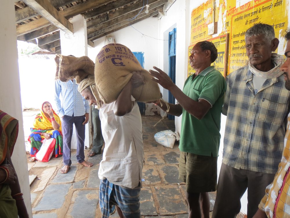 Ram Lal, a ration card holder in Dhamtari, Chhattisgarh takes his ration of 35 kilo rice home.