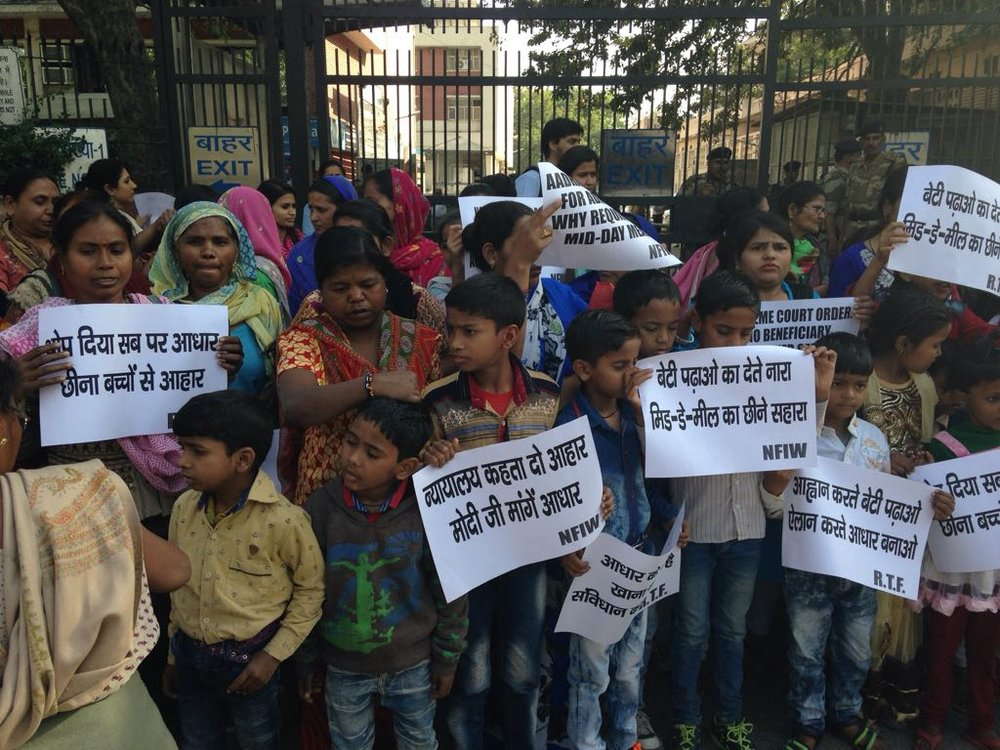 Children and women protesting Aadhaar in mid-day meals outside Shashti Bhawan on March 17.