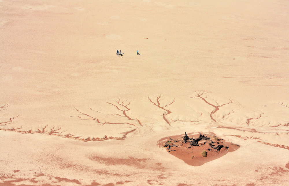 Here a combination of techniques are used, including using scale, finding patterns, and making use of a vantage point to look down on the interest below.  You get an immediate sense of how big the vast open expanse is, simply by noting how small the people within the frame are themselves. [Deadvlei, Sossusvlei - Namibia]