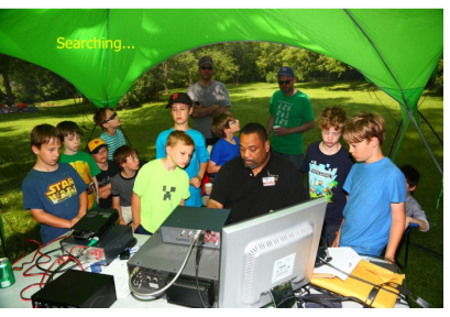 Our President Kelvin (W9BBQ), showing some Boy Scouts how to run the radio.