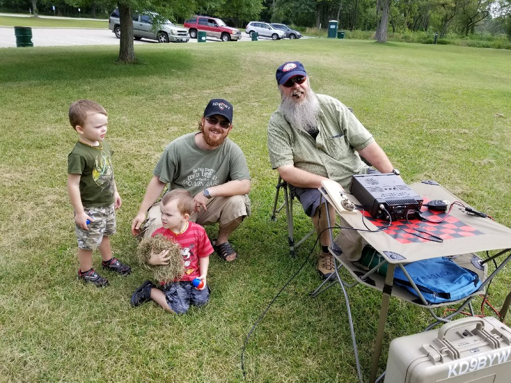 Tim (KD9CWY), Tim's twin boys - Hunter and Archer, and John (KD9BYW) - enjoying the day.