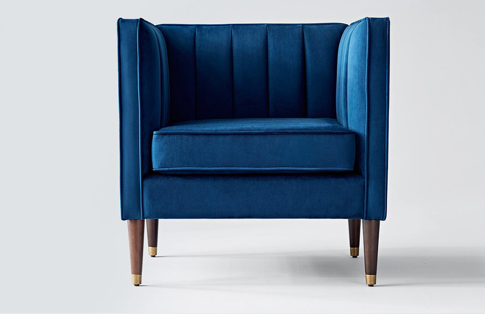 Royal blue tufted velvet chair