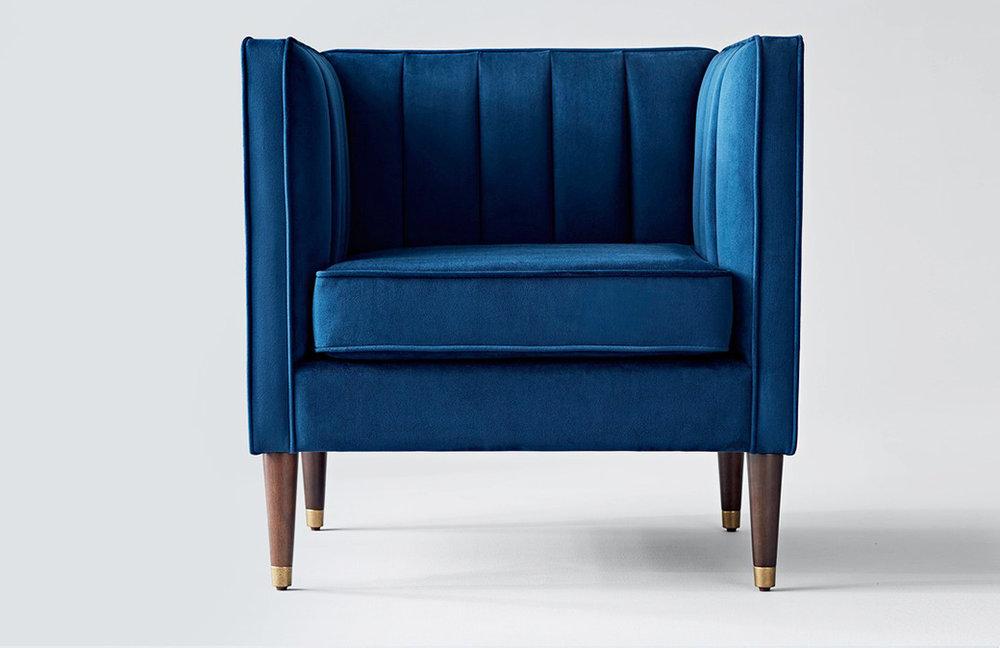 Royal blue tufted velvet chair