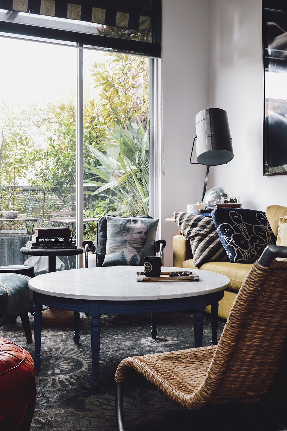 This is a very masculine – and maximalist – space. Thrift-shop chic meets vintage finds, classic pieces join favorite treasures and things have a patina of age. The room is shot through with blues and greys and interesting textures. It looks comfortable and lived in and the owners say it is 'continually evolving'.