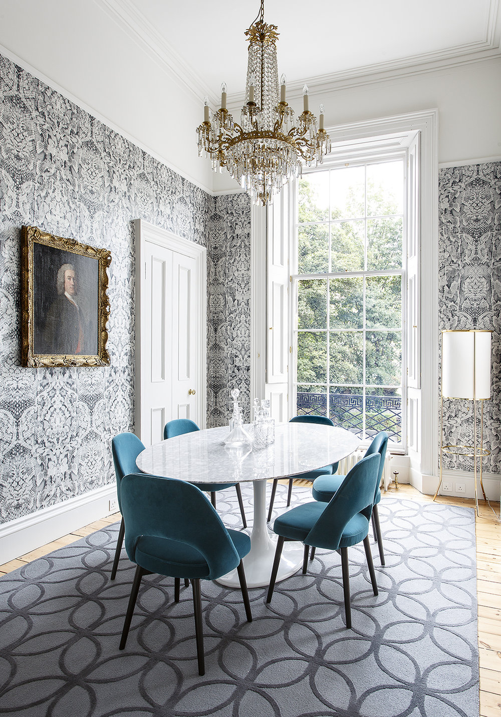 dining room mixes a Georgian chandelier with mid-century Knoll furniture and edgy Damask wallpaper by the Glasgow-based design duo Timorous Beasties.