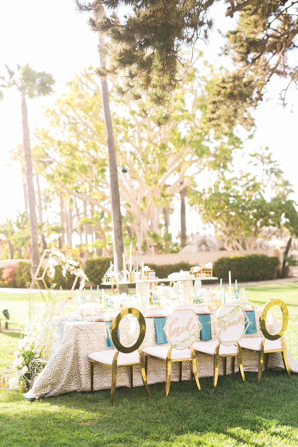 The reception table came together nicely with layers of pattern, reflective glass and copper details, geometric accents, table number and bride and groom chair signs. So much prettiness in one place! And how awesome are the chairs? Rose gold with white leather, what's not to love?