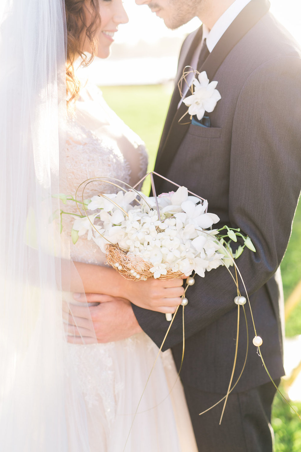 And how unique and creative is this bouquet and boutonniere by Flowerchild?!