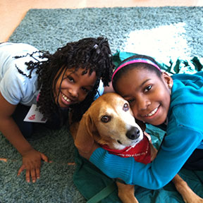 Two students with Certified Reading Assistance Dog