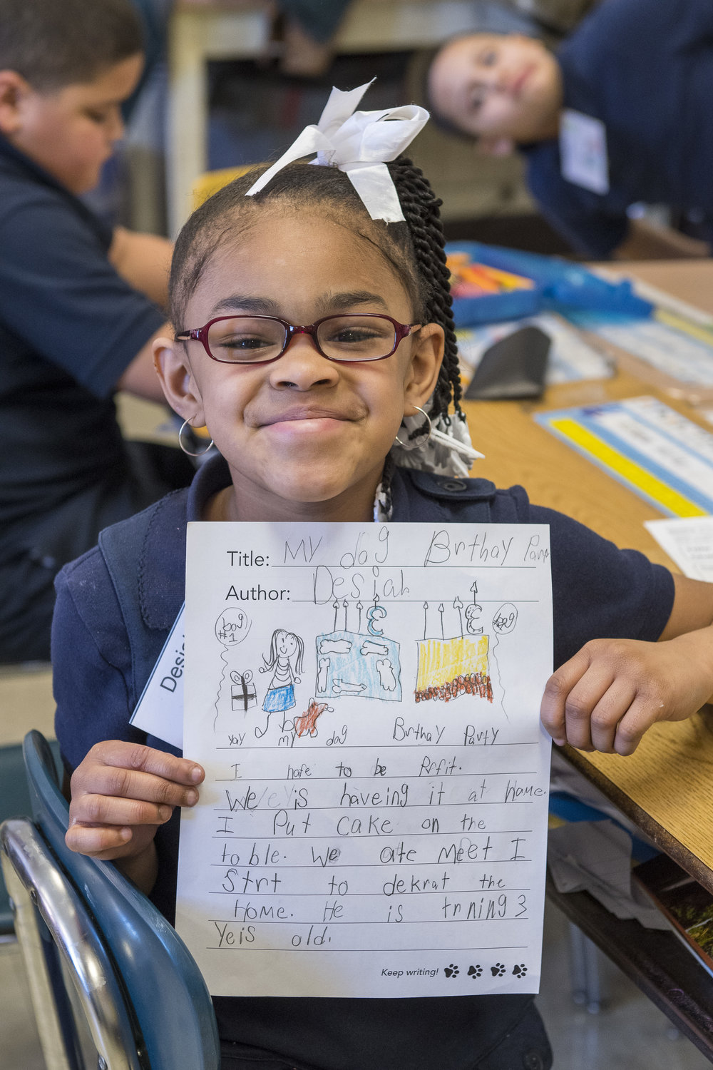 Second-grader Desiah shows off her story in her Tail Blazers program at Cameron Elementary. (M. OBrien)