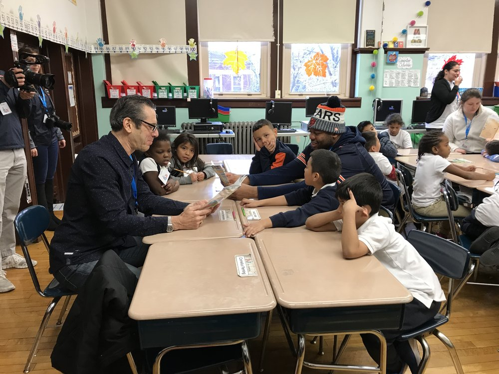 Charles and Mr. Ross reading the book to students (1).jpg
