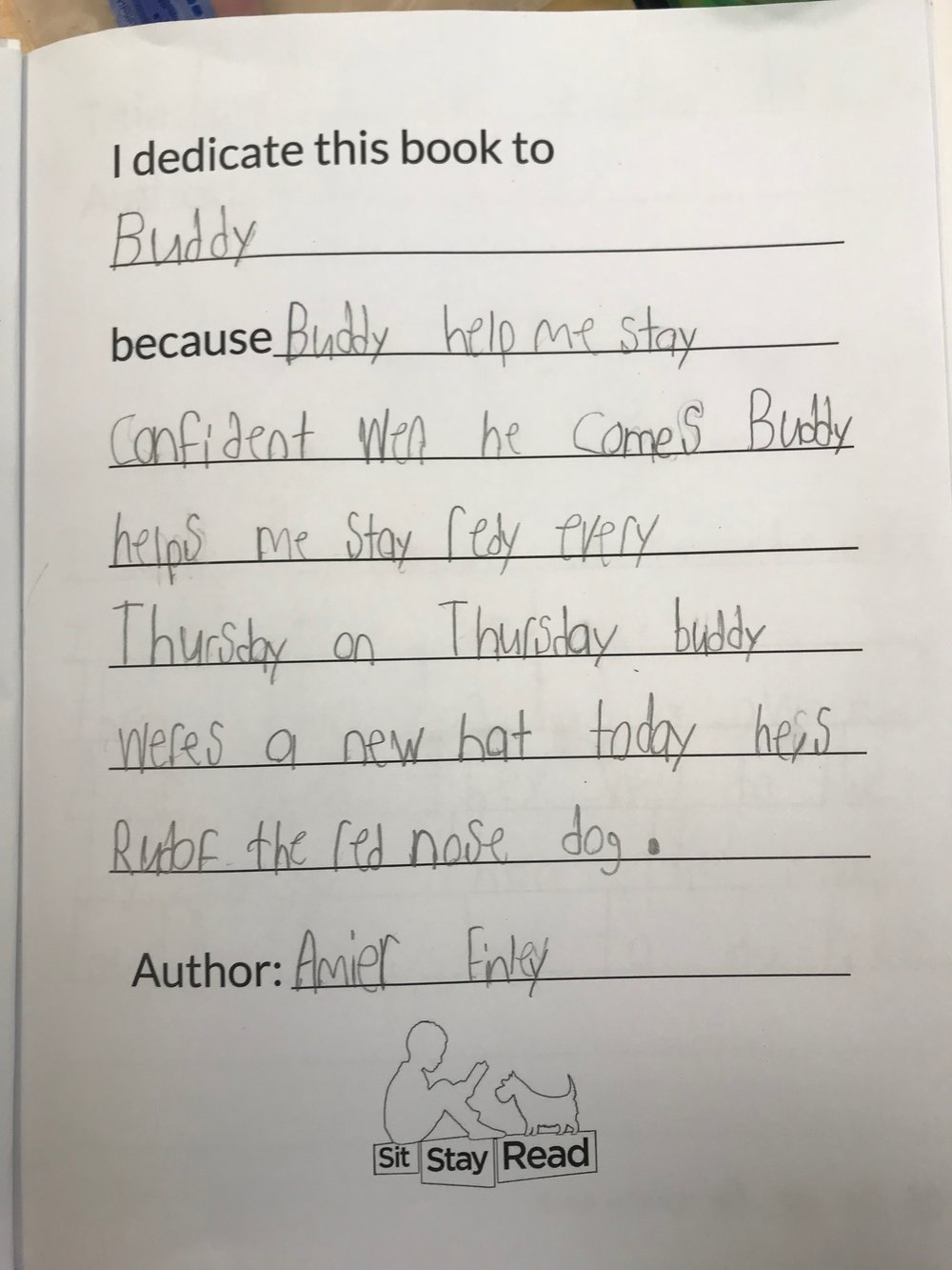 Second-grader Amier's dedication page written out to Certified Reading Assistance Dog Buddy.