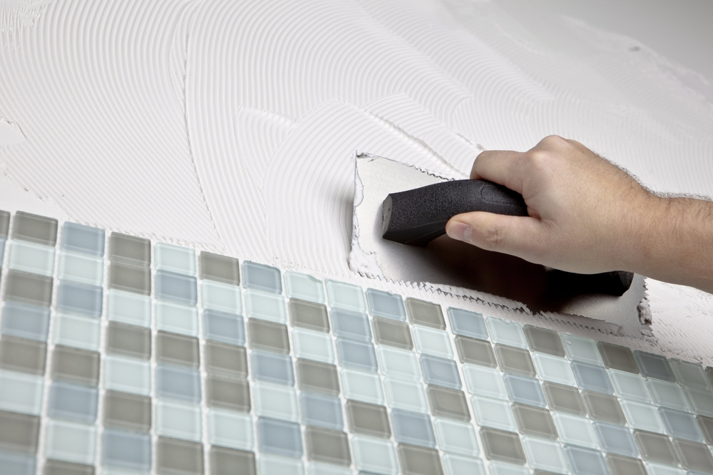 Installer Applying Thinset Next to Glass Mosaic Tile (Medium Size).jpg