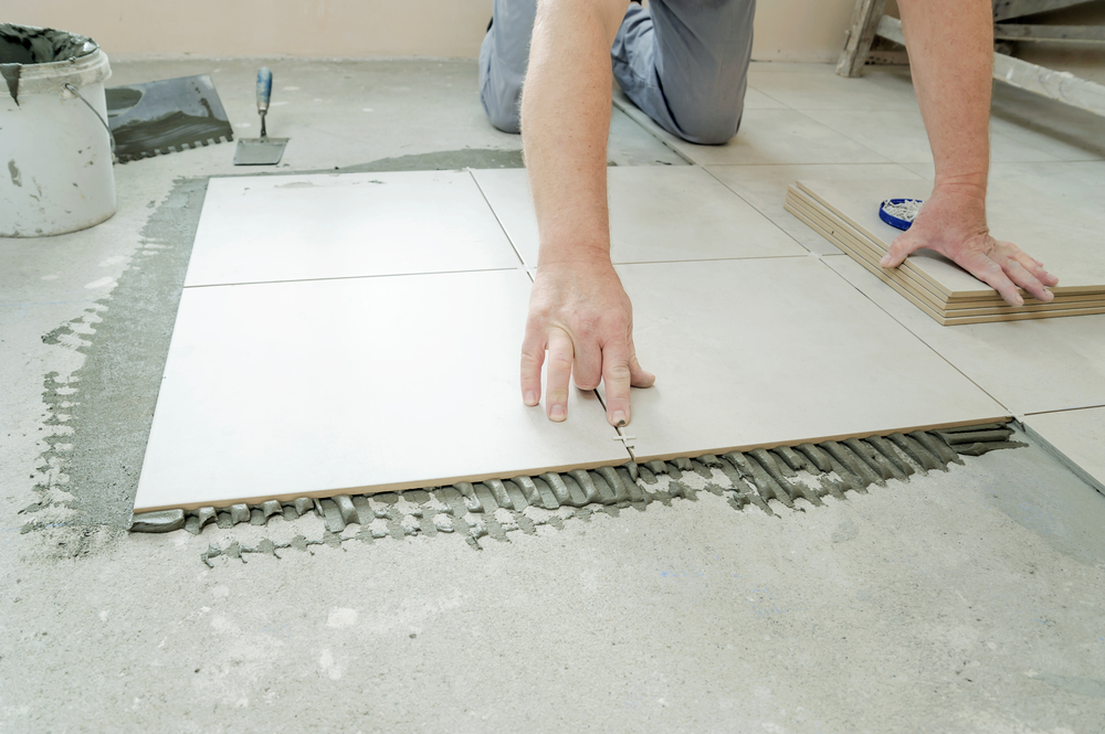 Installer Putting Spacers In Between Porcelain Tile Floors (Medium Size).jpg