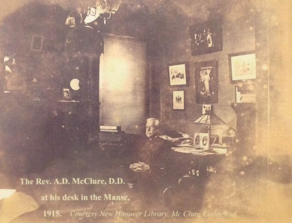 The Rev. A. D. McClure, D. D. at his desk in the Manse, 1915  Photo Courtesy New Hanover Library, McClure Collection