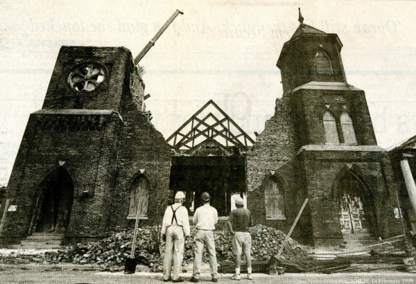 Contruction workers surveying St. Andrew's in 1999 after destruction caused by Hurricanes Bertha, Fran, and Bonnie  Photo Courtesy New Hanover County Public Libary
